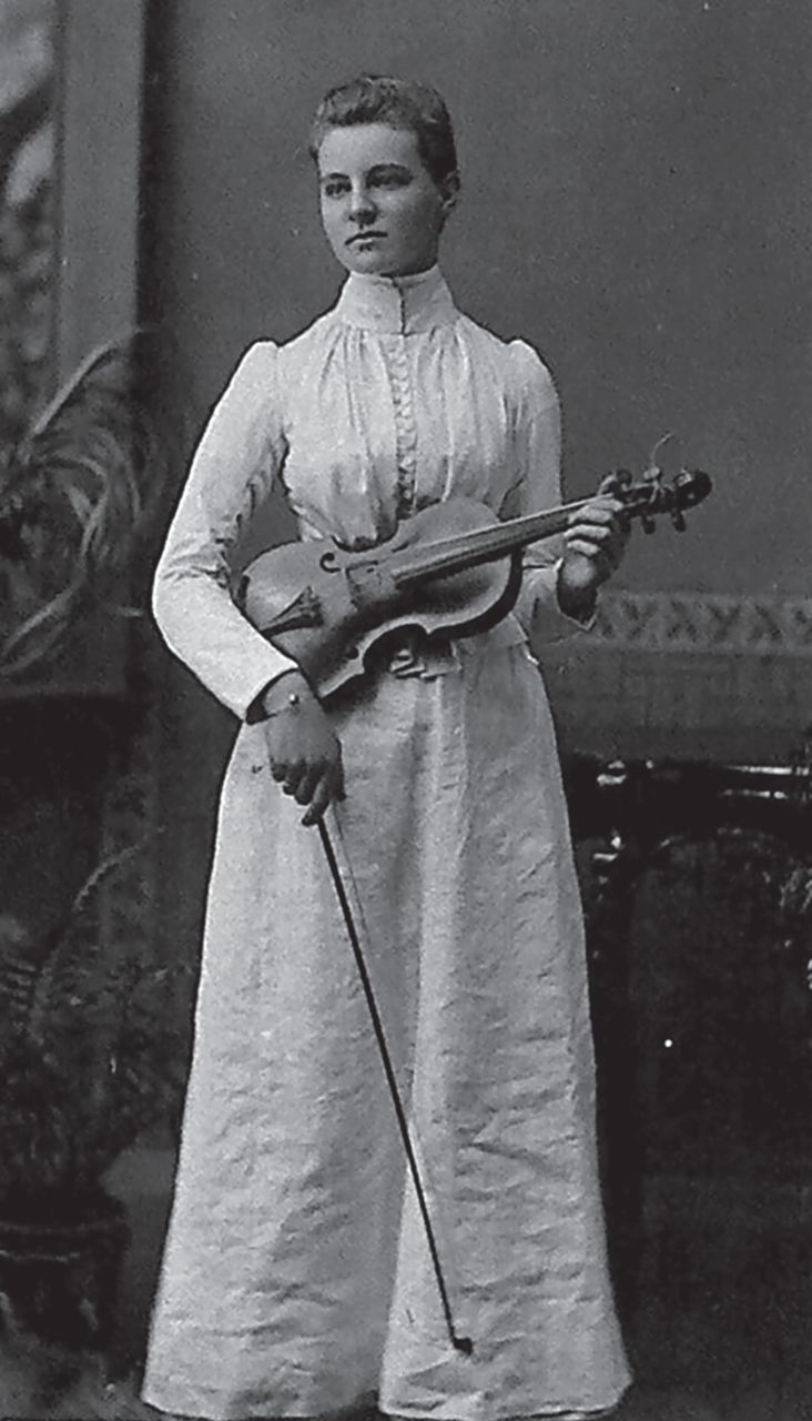 A young Mabel playing the violin
