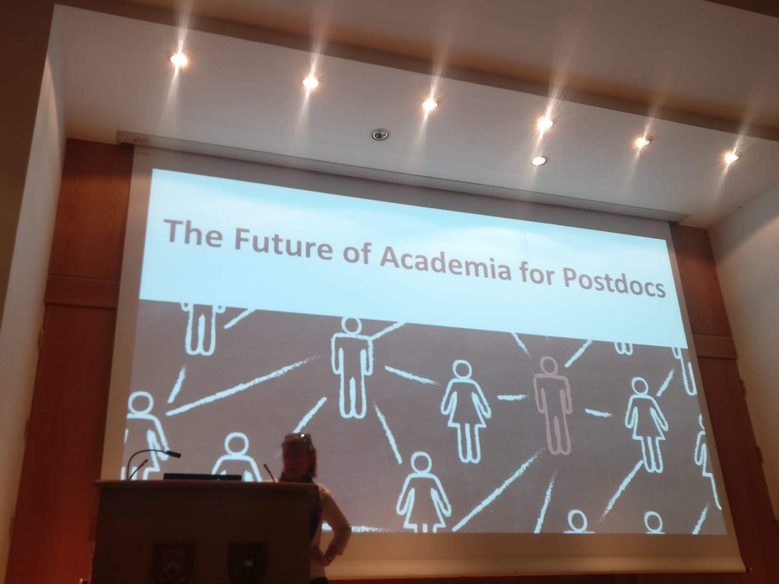 Slide reads 'The Future of Academia for Postdocs'