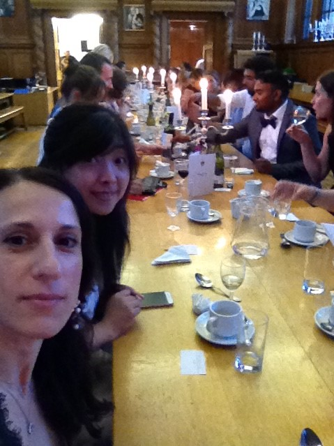 Postdoc rep Stefania Monterisi in the foreground with several postdocs sat at the long dinner table behind her