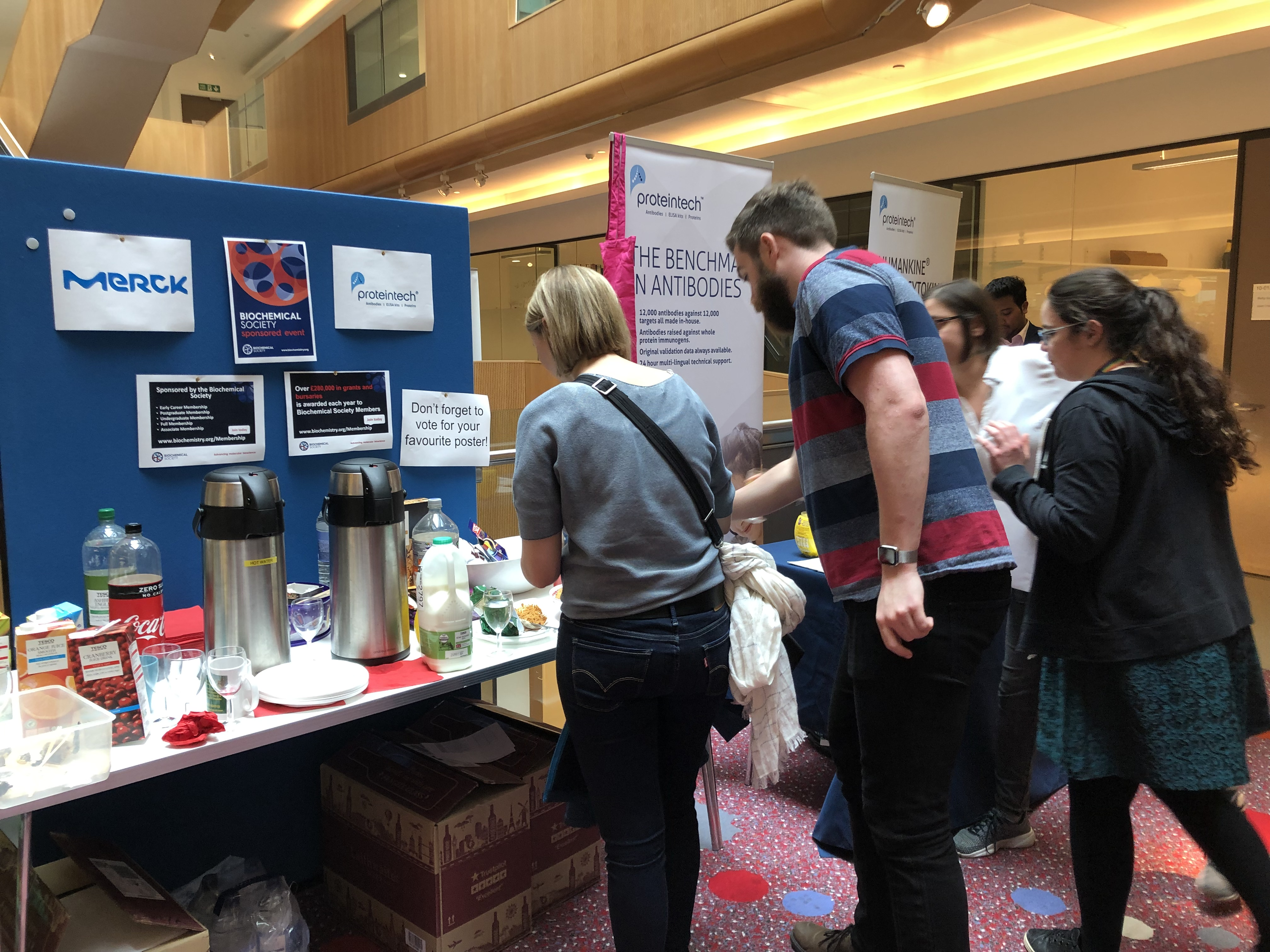 Attendees help themselves to coffee at the poster session.