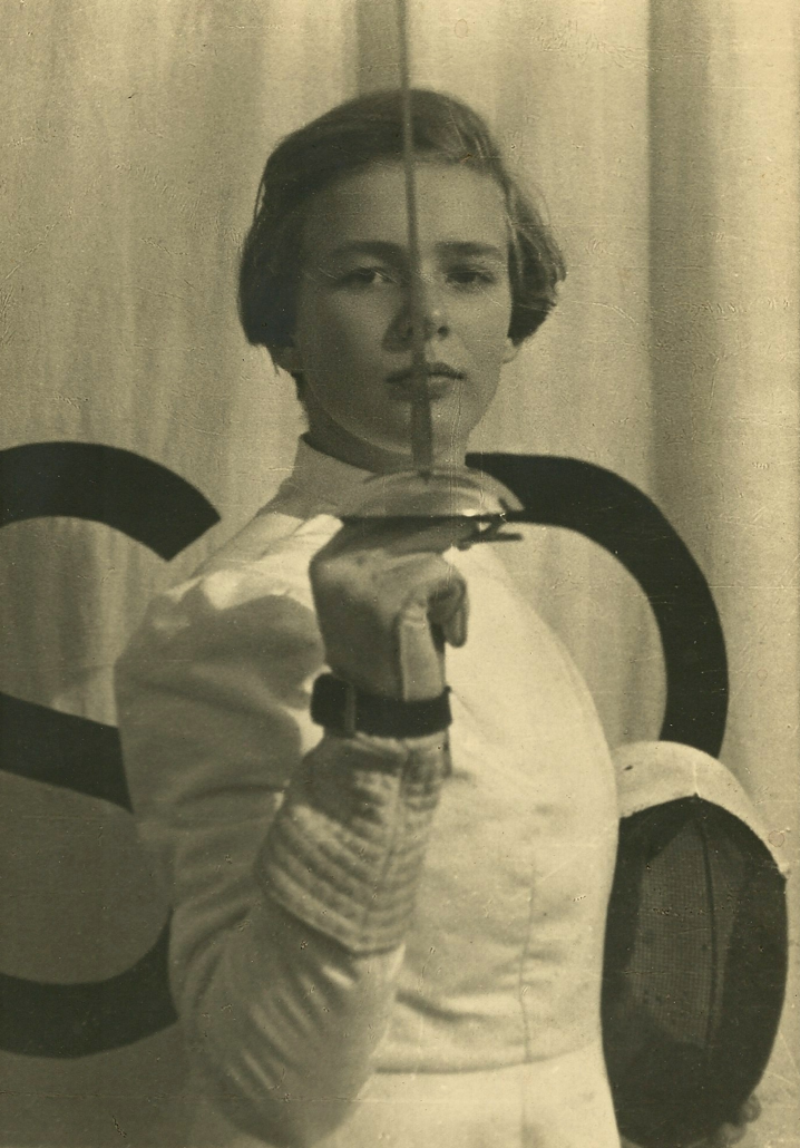 A young Marianne Fillenz raises her fencing sword