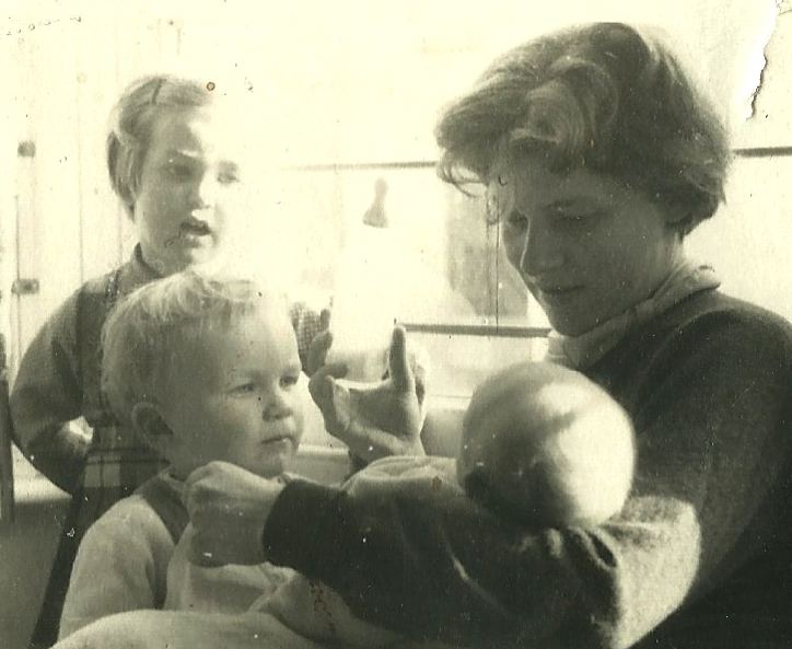 Marianne Fillenz poses holding her baby with her two other children standing by