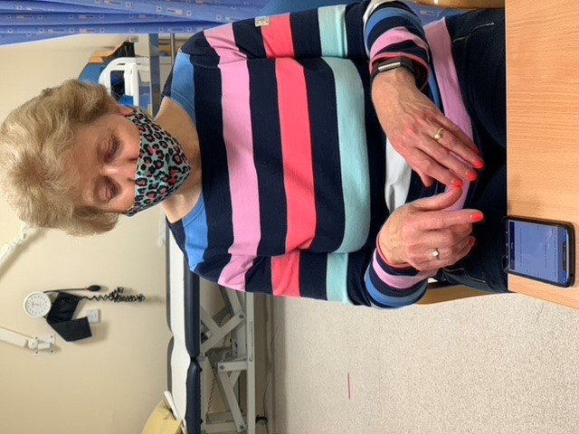 Alison Elkin (OPDC cohort Exenatide participant) conducting the smart phone assessments for the wearables study during a clinic in May 2021